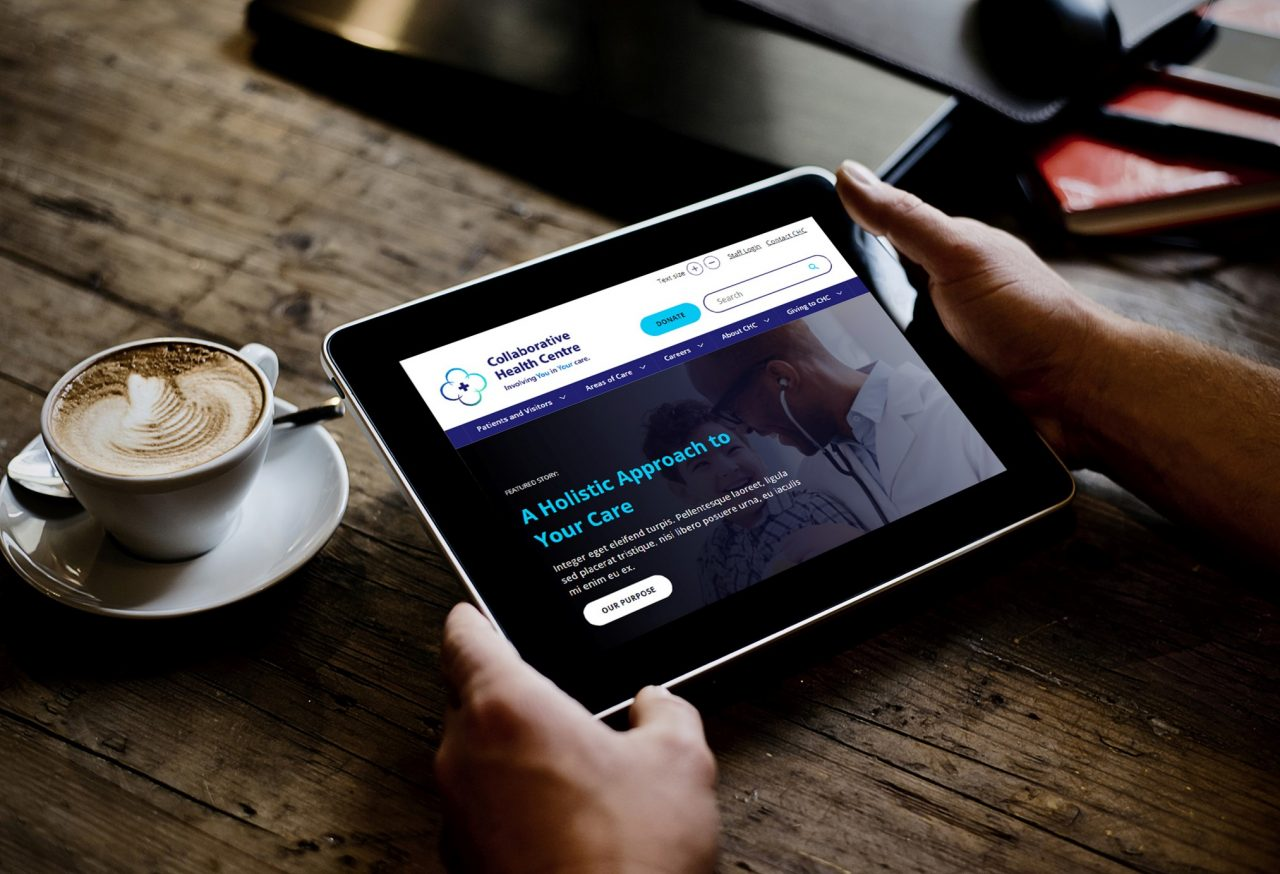 Oasis for Healthcare Website displayed on a tablet in a coffee shop
